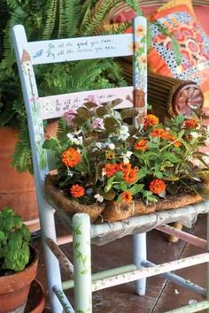 A great way to recycle a worn out chair.  I have a couple we used in the wedding that I could use like this.