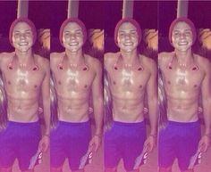Sweaty shirtless Ashton Irwin