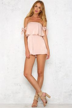 Looking for the perfect date night outfit? You won't be able to look past our strapless Island Life Romper! This gorgeous romper features partial boning at the side seams and side pockets at the waist. An exposed zipper at the back makes it easy to wear. Complete your outfit with a pair of nude lace up heels.  Beige romper. Lined. Cold hand wash only. Model is a standard XS and is wearing S. True to size.  Non stretchy fabric. Polyester.  Runs small, recommended to go a size up.