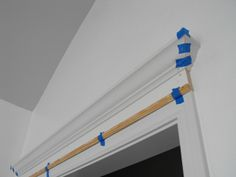 Add moulding to current door header for impressive look! And you don't have to take down the current moulding.