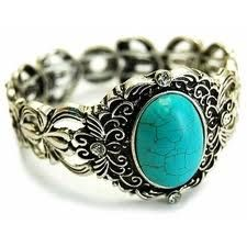 silver and blue ring, swirly
