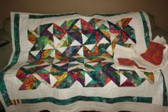 Couple of hours left!  Brightly colored unfinished quilt topper batting pieced back fabric to finish