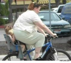 Mom, dont fart again please!!!  (I'm glad she's on a bike, ya got to start somewhere.  But I draw the line at child abuse, horrible to smother your child in public)