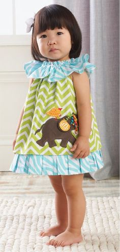 This textured cotton dress from Mud Pie features a trendy chevron green print and a whimsical dimensional elephant and bird applique featuring curly grosgrain ribbons. An oversized ruffle color features an aqua zebra print to match the pleated ruffle of this adorable dress. Fits 2T/3T. Part of Mud Pies Safari baby collection: Jungle animals are hanging around on bright bold patterns in our Safari collection. Paired with unique accessories, the Safari collection is bananas!