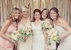 Beautiful flowers, mismatched bridesmaids and a fantastic backdrop of quilting fabric. www.cedarwoodweddings.com