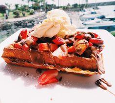 Belgian waffle with Nutella, vanilla ice cream and strawberries