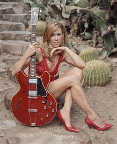 Sheryl Crow. She is dressed in the perfect color for the wedding.