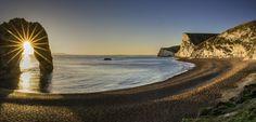Durdle Door Sunburst by Bynack - Show The Beach Photo Contest