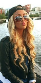 Love this whole look. Wavy hair, sunglasses, hat, leather jacket.