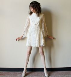 RESERVED - 60s Mod Wedding Dress - vintage micro mini pleated cream white lace angel sleeves empire waist Go-Go frock with bow. $175.00, via Etsy.