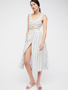 The Simple Life Maxi | In a lightweight cotton-linen blend this maxi dress features a cutout detail at the midriff.    * Open back with crisscross straps   * Exposed button closures in back   * High slit on the skirt