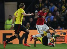 Anthony Martial of Manchester United in action with Adrian Mariappa of Watford during the Premier League match between Watford and Manchester United...