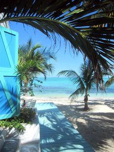 Caribbean + Turquoise Wood Door + Tropical Beach Living