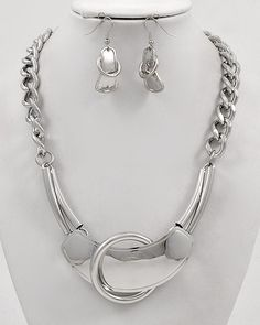 """CHUNKY METAL ART SILVE TONE METAL NECKLACE SET    * If you need a necklace extender I have them for sale in my store.*        NECKLACE: 17.5"""" LONG + EXT    DROP: 1.75"""" L               HOOK EARRINGS: 1"""" L                     COLOR: SILVER TONE  $23.99"""