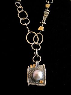 Love the texture with the elegance of the pearl.  Contrast!