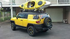 FJ Cruiser, lifted, blacked out, with homemade kayak rack. Can't wait to take it to the lake camping.