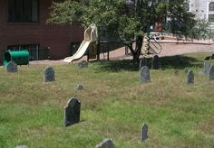Yet another unfortunate juxtaposition of playground & cemetery...