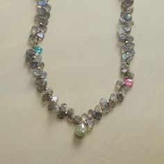 """EVERY WHICH WAY NECKLACE--Loads of labradorites strung on silk thread welcome the occasional appearance by apatite, turquoise, pink sapphire and moss aqua. Exclusive. Handmade with sterling silver beads and hook clasp. 18""""L."""