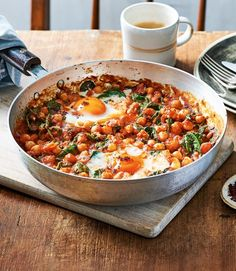 Spicy baked eggs with tomatoes and chickpeas Dr Rupy Aujla's baked eggs recipe uses fibre-rich chickpeas to keep you feeling full and is spiked with harissa paste for an extra fiery kick. It's a wonderful brunch dish for the weekend or even as a Spicy Recipes, Cooking Recipes, Healthy Chickpea Recipes, Cooking Eggs, Healthy Tasty Recipes, Quick Egg Recipes, Mama Cooking, Kid Recipes, Blender Recipes