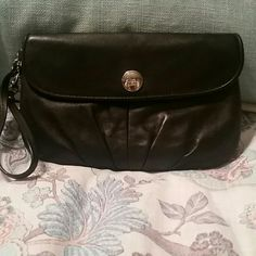 Authentic Coach Wristlet Fairly used, black, AUTHENTIC Coach wristlet. This bag can also be used as a clutch. It is in GOOD condition on the outside but a bit dirty on the inside which is why price is low. Leather is in great like new condition. Coach Bags Clutches & Wristlets