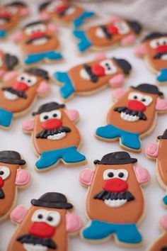 """Potato Head Cookies for a Birthday Party These fabulous ideas will take your Toy Story birthday party to infinity and beyond! There may be no """"snake in [your] boots"""", but these 21 Toy Story themed birthday party ideas will add pep to Fête Toy Story, Toy Story Baby, Toy Story Theme, Toy Story Food, Toy Store 4, Festa Toy Store, Toy Story Cupcakes, Toy Story Cookies, Toy Story Birthday Cake"""