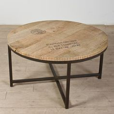 @Overstock - This simplistic table has a stamped and scraped surface, giving it a rustic, unique look as part of any room decor. This natural toned table is sturdy and unique.http://www.overstock.com/Worldstock-Fair-Trade/Ayodhya-Round-Coffee-Table-India/6710409/product.html?CID=214117 $294.99