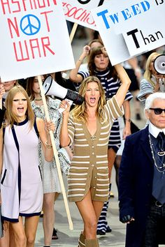 Karl Lagerfeld and Gisele Bundchen led runway models in a fake protest during Chanel's #PFW show today.