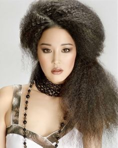A long black curly frizzy afro hairstyle by Hooker & Young