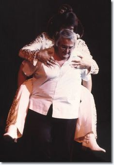 Lamar Fike, a TRAITOR after Elvis passed, carrying Elvis around on stage as a joke, as Elvis still had the stuffed monkey on his back..Las Vegas Hilton, September 3, 1973