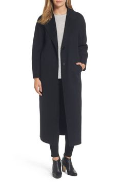Cut with a long, maxi-length silhouette and classic styling, this double-faced wool reefer coat is a study in pared-back elegance.