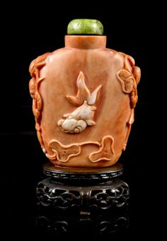 A Carved Coral Snuff Bottle, Height 2 1/8 inches.