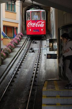 Coca Cola Coke sign on a train.
