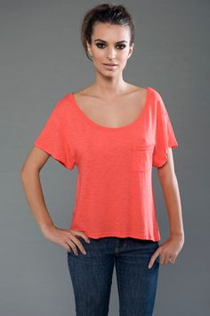 BP - 4SMSL707 - Front - Coral -- eco-HYBRID™ Slub Micro Jersey Short Sleeve Scoop Neck Pocket Tee -- Drapes beautifully. The uber-soft & lightweight eco-friendly fabric is slubbed for the desired effect of having small, soft, thick nubs in the yarn. Made in USA  • 1x1 rib binding at neck