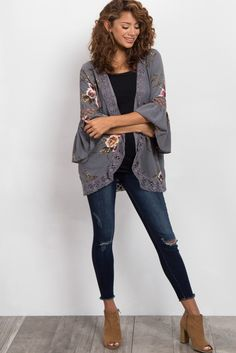 Florals are a must-have in every girl's closet. With feminine crochet accents and ruffle sleeves, this floral printed maternity kimono is perfect for layering. Style this kimono with your favorite jeans, a basic top, and booties for a fun, playful ensemble for any occasion.