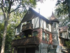 CURB APPEAL – another great example of beautiful design. Tudor swoon. Love the balcony & turret.