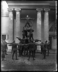 https://flic.kr/p/NUoigw | Soldiers making a human pyramid VPL 18401 | Soldiers forming a human pyramid VPL 18401 Date: 191- Photographer/Studio: Smith, Harold Content: [architectural pillars] Topic: Military bases Uniforms Militia Soldiers More information on our historical photograph collection: www.vpl.ca/historicalphotos