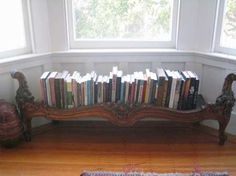 An antique footboard makes an inviting book holder/display.   www.pcniu.com