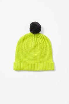 Green pom-pom hat