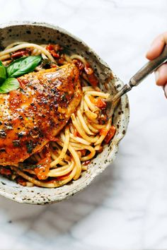 Garlic Basil Chicken with Tomato Butter Sauce - you won't believe that this real food recipe only requires 7 simple ingredients: chicken, pasta, garlic, olive oil, tomatoes, basil, butter. SO good! | pinchofyum.com.