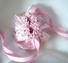 Gorgeous Soft Rose Pink Satin Drawstring Jewelry Pouch(es) made to order. Price for ONE (1) bag $16 Discount on 3 or more. Select Quantity https://www.etsy.com/listing/242013371/pink-satin-pouches-ribbon-drawstring