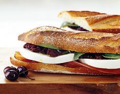 "Mozzarella and Prosciutto Sandwiches with Tapenade for the Epicurious Game Day Giveaway.  Tick tock!  All entries must be received by tomorrow at noon EST.  Visit our blog ASAP for details on how you could win a 42"" TV: http://www.epicurious.com/articlesguides/blogs/editor/2013/01/enter-epicurious-gameday-giveaway-on-pinterest.html"