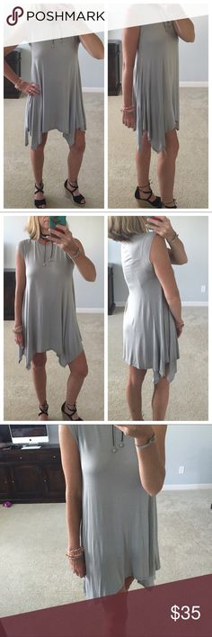 """Grey Tunic/Dress Super cute Grey Tunic/Dress. Super cute dress for the summer and add some leggings and ankle boots in the Fall. Short sleeves. Handkerchief hem. True to size. Measurements laying flat: Small: 16"""" pit to pit. Medium: 17"""" pit to pit. Large: 18"""" pit to pit. 95 modal 5 spandex. Modeling size Small. New Boutique Item, without tags. #BA22 Promesa Dresses"""