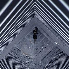 Light projected into a mirrored room creates seemingly infinite patterns in this installation by Turkish artist Refik Anadol, at this year's SXSW festival.