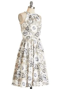 Pros and Congrats Dress. The time has come where youre now recognized as a professional of your craft, and to celebrate youve donned this beige A-line - flourishing with black and white sketch-like flowers. #tan #modcloth