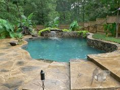 Natural pool with waterfall and multi level patio.  http://www.parrotbaypools.com #PoolBuilders #LittleRock