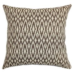 Bring a rich texture to your interiors by decorating this striking accent piece. This square pillow features an inventive design showcasing a traditional ikat print which gives off a warm vibe with its chocolate brown and white color palette. Pair this pillow with a matching ikat pattern to complete your collection. Top off your bed, couch or seat with this plush and comfy throw pillow, which is made from 100% soft cotton fabric. $55.00  #ikatprint #ikatpillow #tosspillow