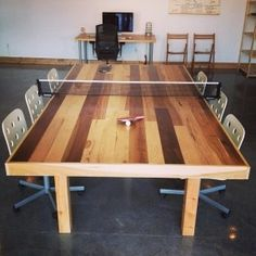 DIY, conference / ping pong table we built out of reclaimed hardwood floor planks for our studio space.