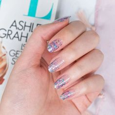Paint your fingertips with the coolest fall nail designs to instantly graduate your look from basic to brilliant. Less Bitter, More Glitter is a mix of pastel blue, pink, lavender, and silver glitter on clear! Wear this glitter-dipped look alone or over your favorite color. Get quick stylish nails in minutes with Color Streets fall nail inspiration that fit for any style or occasion. #fallnaildesign #colorstreetnails #prettynailartdesign