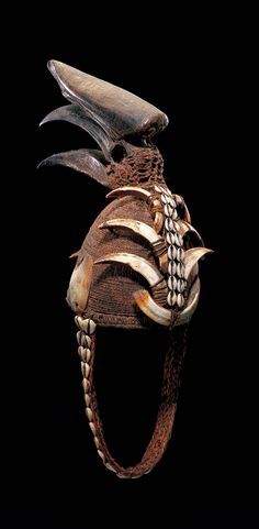 Africa | Man's bwami hat from the Lega people of the DR Congo.  Plant fiber, shells, hornbill skull, tusks, cowrie shells.  ca. prior to 1960