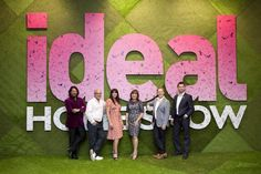 The Ideal Home Show Scotland 2012 team in front of the giant logo installation.